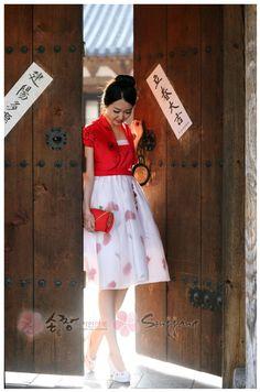 Can be found here: http://www.sonjjang-hanbok.com/korean-prom-dresses/2013-short-dresses/korea-clothes-dress-mini-bakrihyang.html