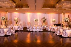 Soft white uplighting around the perimeter of the hall. A perfect accent to a magical night.