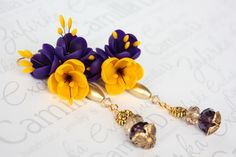LIKE THE EARRING BOTTOMS WITH OPEN BEAD CAP...........................Earrings with yellow flowers