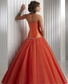 Wow. This is a BEAUTIFUL dress. The color is lovely, and I adore the full skirt and lace up detailing. Lovely. :)