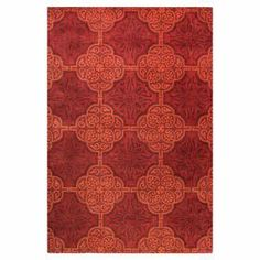 Hand-tufted wool rug with a red medallion motif.  Product: RugConstruction Material: 100% WoolColor: Red Note: Please be aware that actual colors may vary from those shown on your screen. Accent rugs may also not show the entire pattern that the corresponding area rugs have.Cleaning and Care: Regular vacuuming and spot cleaning recommended