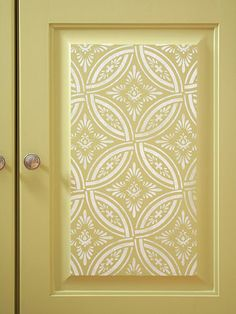 Custom Piece  Stenciling lent the armoire the charm of hand-painting without a lot of fuss. If stenciling isn't your thing, cover the recessed or raised portion of door panels with wallpaper. Select a pattern that fits well within the panel.