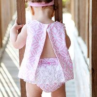RuffleButts celebrates how quickly a moment can become a memory by creating timeless, frilly designs that reflect the magic of childhood. Home to the original ruffle bloomer, RuffleButts is known for their high-quality fabrics and impeccable craftsmanship. By affixing frills to every style, they're able to emulate a girl's natural charm: It's the flounce that counts!