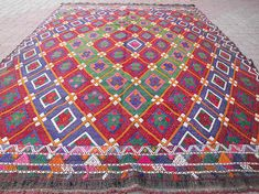 Check out this item in my Etsy shop https://www.etsy.com/listing/543530454/vintage-turkish-kilim-rug-colorful-rug