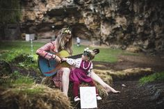 Found this rad old guitar whilst exploring the natural amphitheater at @wavehouse_studios....thought I would try bust out a tune or two.....not sure if Summer is enjoying my terrible playing....or telling me to stop  We are also both dressed head to toe in West Aussie brands....make sure you go check them out!! Flowercrowns: @blooming.bohemian  My dress/kimono: @three_little_birds_shop  Bracelets: @lacedwithkindness  Summers Pinnie & Tights: @sugarplumtree_australia  Summers Top…