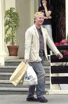 2004 - Alan Rickman out and about and ... shopping. No specific date given; no location given.