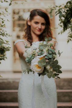 Beautiful bride , green bouquet