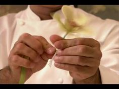 "From ""Sugar Rush"" with Warren Brown. Ron demonstrate making of sugar orchids and wedding cake with edible blooms."