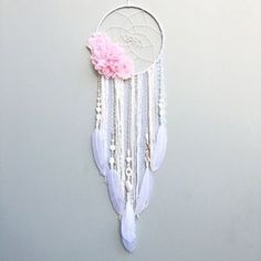 Flower dream catcher, custom made by Inspired Soul Shop on Etsy. Dreamcatcher decor is beautiful for any bedroom, nursery, or living space. This