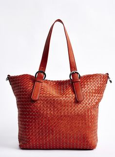 http://www.charmingcharlie.com  My new favorite store. Charming Charlie  ORANGE tote