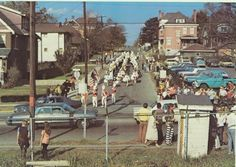 Roger Bacon Band marching to their FB game on Leonard Ave circa 1970's.