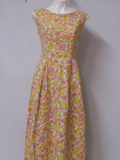 $48 - 60s -Home Sewn- Womens creamy off white background thick cotton blend, floral print, floor length tank dress with rounded neckline, back metal zip closure, princess seaming and mid waist styling that falls to full box pleated skirt.