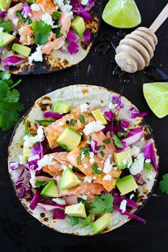 Honey Lime Salmon Tacos Recipe on twopeasandtheirpod.com The slightly sweet honey lime glaze makes these salmon tacos extra delicious. They take less than 30 minutes to make and are great for Taco Tuesday or any day!