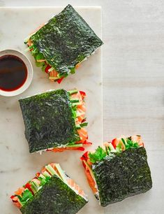 A new way to eat sushi! Fill your nori wraps with sushi-grade salmon, red pepper, cucumber and sushi rice, then dip in soy sauce for best results Best Sandwich Recipes, Sushi Recipes, Salmon Recipes, Asian Recipes, Yummy Recipes, Sushi Sandwich, Make Your Own Sushi, Sushi Dishes, Kitchens