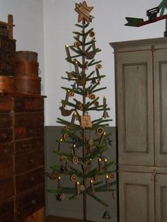 I love this primitive Christmas tree - I have just the spot for it.
