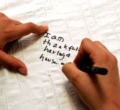 writing what you're thankful for each year on a tablecloth--great family keepsake