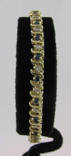 14KT YELLOW GOLD 1980'S 2.50 CARAT DIAMOND & SAPPHIRE S LINK TENNIS BRACELET