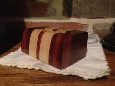 Iphone 5 wood charging dock made from Rosewood with oak accent stripes. $60.00, via Etsy.