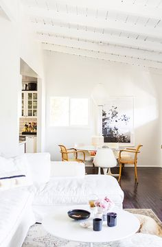 White sofa and tulip dining table in in the relaxed and light-filled L.A home of Victoria from SF Girl By Bay. Laure Joliet.