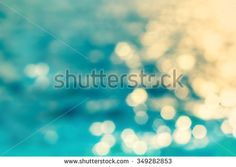 Beautiful natural water background with bokeh lights  - stock photo