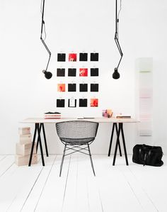 Minimalistic, white, office space with some cool celling lamps