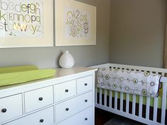 Gorgeous green and gray nursery with walls painted Sherwin Williams Pussy Willow paired with framed alphabet and number art over a white dresser with oil-rubbed bronze pulls alongside a white crib dressed in the Olli and Lime George Crib Collection. Grey Bathroom Paint, Grey Bathrooms, Grey Paint, Nursery Dresser, Nursery Bedding, Grey Wall Color, Yellow Nursery, Grey Walls, Pallets