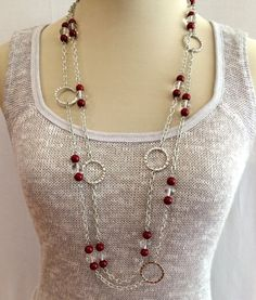 These beaded necklaces contain beautiful dark red coral and quartz. Since these necklaces have a clasp they are adjustable. They can be worn in