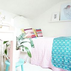 Colourful loft bedroom , boho cushion,desenio prints and ikea picture ledge