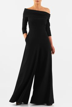 Make the most of the seventies trend in our flattering cotton knit jumpsuit with a ruched pleat fold-over off-the-shoulder top and finished with flowing wide legs.