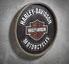 """Barrel End Wooden Sign Unique design of the Barrel End Wood Sign will rev up your home décor. Vintage-style barrel end plywood sign Direct printed Bar and Shield graphic Not intended for outdoor use Hanging bracket included Measures 23"""" diameter #HarleyDavidson"""