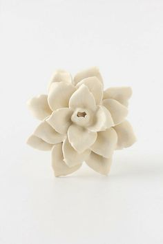 Linen Flower Knob #anthropologie  I love how easy you can up-do your furniture just by changing a few knobs
