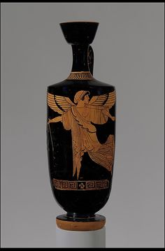 Terracotta lekythos (oil flask)  Attributed to the manner of Douris     Period:      Classical  Date:      ca. 480–470 B.C.  Culture:      Greek, Attic  Medium:      Terracotta  Dimensions:      H. 10 7/8 in. (27.6 cm); diameter 3 11/16 in (9.4 cm)  Classification:      Vases