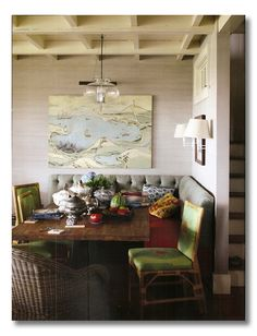 A great use of space and a great way to dress up a kitchen nook! Have you considered a dining banquette and chairs?