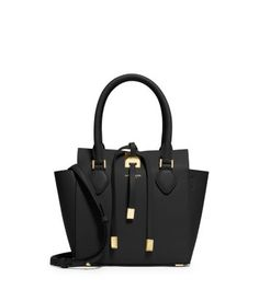 In a scaled-down silhouette, consider our extra-small Miranda one of life's little luxuries. In true Michael Kors fashion, we accented the supple calf leather with polished hardware and protective metal feet. Whether you tote it by the top handles or opt for the shoulder strap, it's an instant outfit elevator.