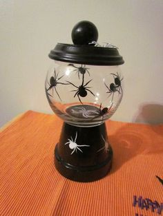 Halloween Spider Candy Dish I made using clay pots, Dollar Store glass vase, acrylic paint and vinyl Bonbon Halloween, Halloween Clay, Halloween Spider, Halloween Projects, Diy Halloween Decorations, Halloween Crafts To Sell, Clay Pot Projects, Clay Pot Crafts, Jar Crafts