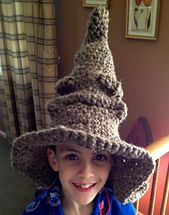 Free pattern for making a quick and easy Harry Potter Sorting Hat! Uses double strands of worsted or one strand of chenille, made with a large hook.