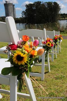Bright and colourful pew flowers for the beautiful outdoor ceremony