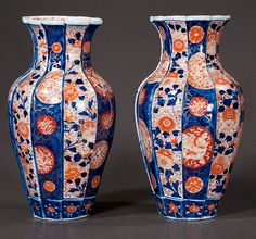 "Pair of Imari porcelain vases with ribbed design and cobalt blue and bittersweet bird and floral decoration, c.1870, 12"" high"