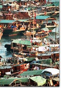 Aberdeen Fishing Village in Hong Kong where families live on these boats...an amazing trip back in time