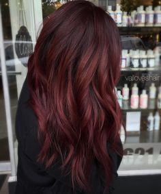 Pick a rich shade of burgundy red that blends out nicely in a pretty balayage effect