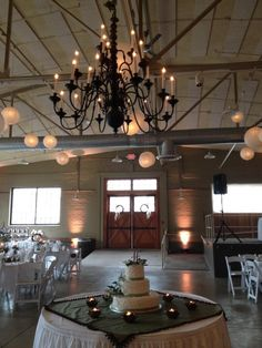 Early Fall Wedding at The Prairie Street Brewhouse - Olive, Copper and Creme.  Wedding  Cake - Focal Point - Center of the Room - Under the Chandelier.   Megan and Marc l Artichokes and Gardenias by Backyard Soiree Weddings and Events