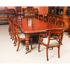 A lovely dining set comprising an antique William IV solid mahogany pullout dining table and a set of 12 bespoke dining chairs.