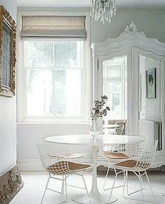 old and new white harry bertoia chairs and round table