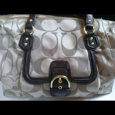 Large coach bag Beautiful brand new coach hand bag. Its like a tan color with chocolate brown leather. Signature c design satchel style. Authentic. CHEAPER THRU MERCARI APP Coach Bags Satchels