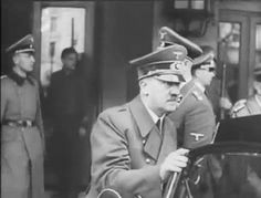 """Hitler getting into his Mercedes in 1942 with his valet, Heinz Linge, behind him. It was to Linge that Hitler entrusted the chore of burning his corpse along with the corpse of his wife of one day, Eva Braun. Linge spent the next 11 years being periodically tortured in a Soviet Gulag, as they tried to get him to admit that Hitler had""""escaped"""" the Bunker"""