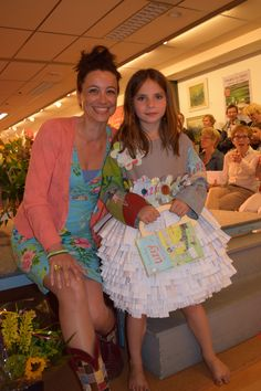 This beautiful paper dress was made from books in the Lizzy series by author Suzanne Buis from The Netherlands (in the picture with model Julia): www.suzannebuis.lizzy.html  Creators of the dress: www.driecreatievewieven.nl  How about that for recycling, haute couture, fashion, paper art... An inspiring project for young children, who designed and made their own outfits!
