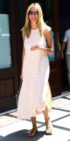 While Heidi Klum's silky white midi easily translates to an evening out, we love the effortless way she's made the style more casual: with flat thong sandals, a sturdy carryall, and oversized round sunglasses.