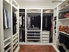 a large walk-in closet full of Ikea PAX wardrobe units featuring glass front drawer fronts is highly organized for clothing storage