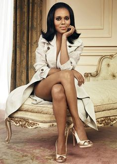 Kerry Washington LOOKING fabulous on an antique chaise louse in stilettos and an ivory trench coat. The flip of her hair and her legs seal the picture perfect.
