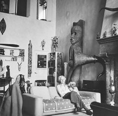 Max Ernst with a dog at Peggy Guggenheimer's home